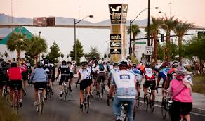 Cyclists pass the renowned World Market Center in Las Vegas